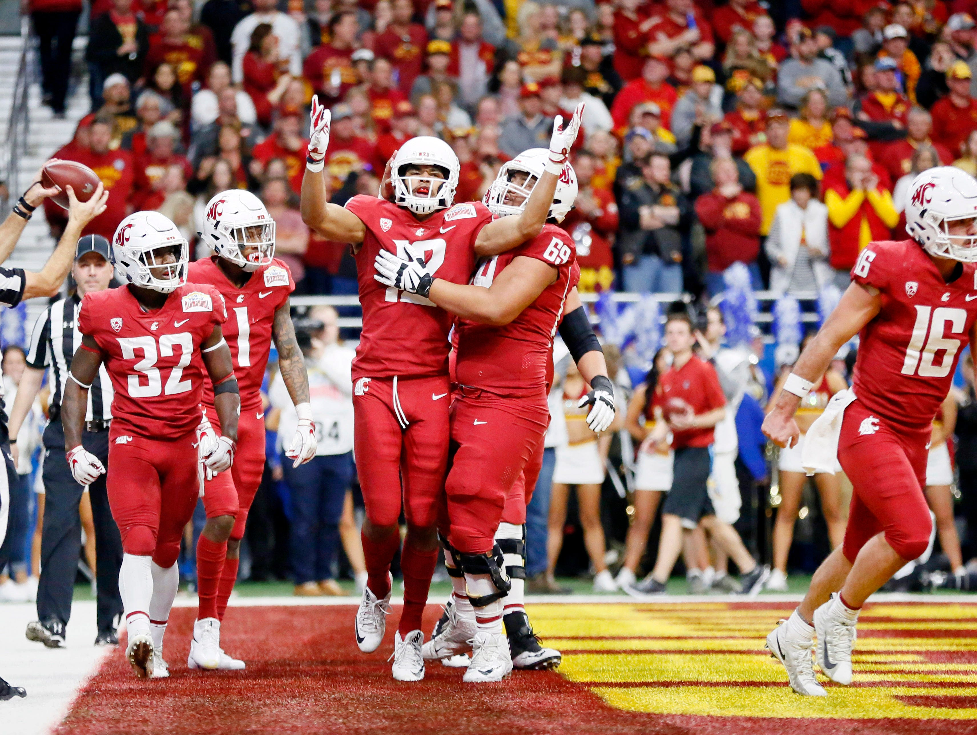 Washington State Cougars wide receiver Dezmon Patmon (12) celebrates with teammates after scoring a touchdown during the first half against the Iowa State Cyclones in the Alamo Bowl.