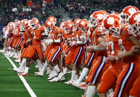 Cotton Bowl: Clemson Tigers players walk the field before college football playoff semifinal game.