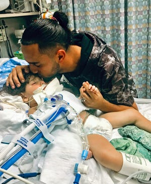 In this recent undated photo, released Monday, Dec. 17, 2018, by the Council on American-Islamic Relations in Sacramento, Calif., Ali Hassan kissing his dying 2-year-old son Abdullah in a Sacramento hospital. Abdullah Hassan, the son of a Yemeni woman who sued the Trump administration to let her into the country to be with the ailing boy has died. The boy died on Friday, Dec. 28.