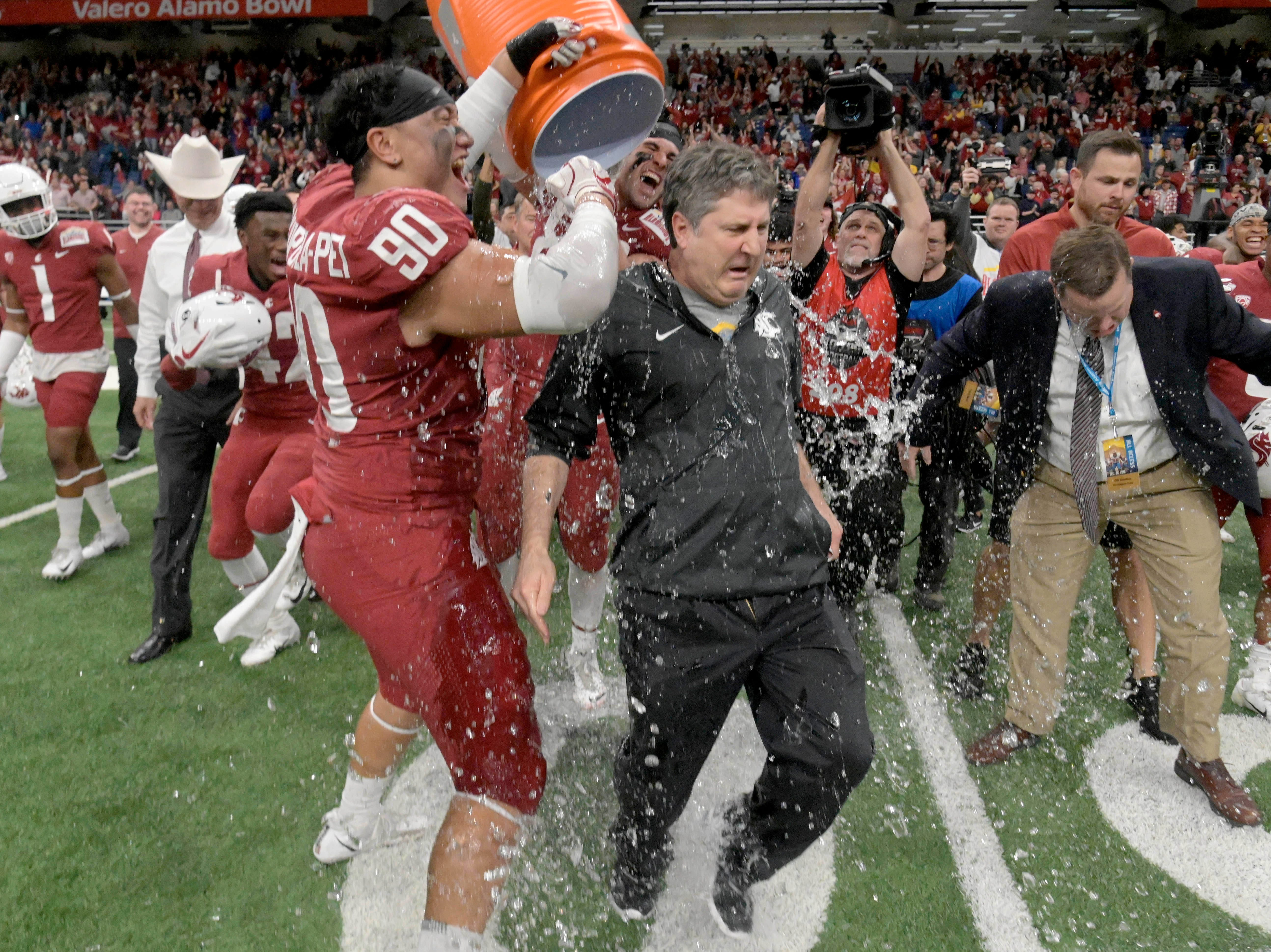 The Washington State Cougars douse head coach Mike Leach after beating Iowa State in the Alamo Bowl.