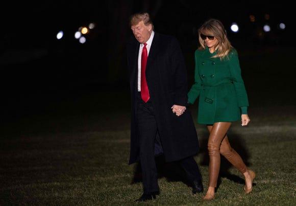 President Donald Trump and First Lady Melania Trump arrive at the White House in Washington, DC, on Dec. 27, 2018, as they return from an unannounced trip to Iraq.