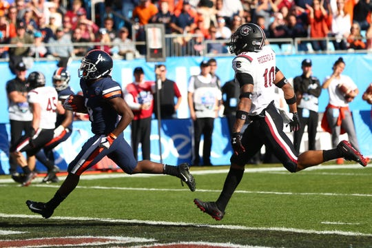 Virginia Cavaliers wide receiver Olamide Zaccheaus (4) carries the ball for a touchdown in the third quarter against South Carolina Gamecocks in the Belk Bowl.