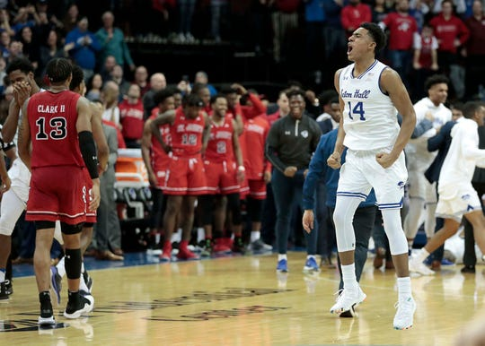 Seton Hall Pirates guard Jared Rhoden (14) celebrates after making a three point basket in front of St. John's Red Storm forward Marvin Clark II (13) during the second half at Prudential Center.