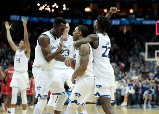 Seton Hall Pirates guard Shavar Reynolds (33) celebrates with teammates after the game against the St. John's Red Storm at Prudential Center.
