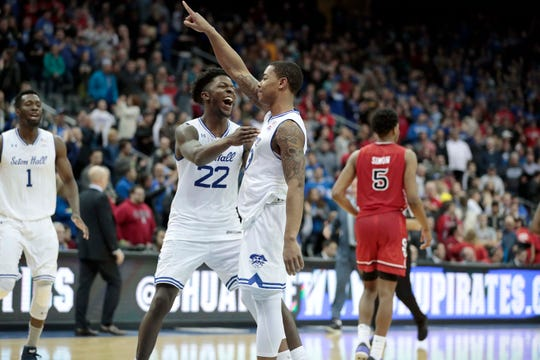 Seton Hall Pirates guard Shavar Reynolds (33) celebrates with guard Myles Cale (22) in front of St. John's Red Storm guard Justin Simon (5) after the game at Prudential Center.