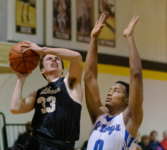 Southern Regional's Cole Markley works in against St Mary's Jorman Salono. Southern Regional vs St Mary's in semifinals of Score at the Shore tournament in Stafford, NJ on December 29, 2018.