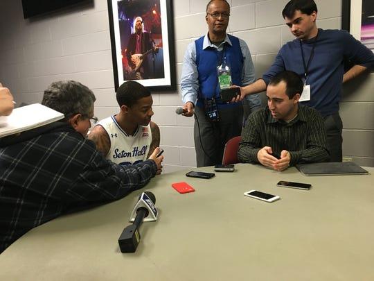 Shavar Reynolds speaks with reporters after his game-winning shot.