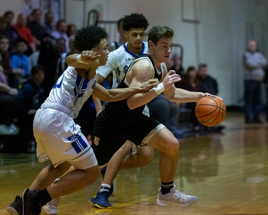 Southern's Vinnie Deck works in between two St. Mary players during first half action. Southern Regional vs St Mary's in semifinals of Score at the Shore tournament in Stafford, NJ on December 29, 2018.