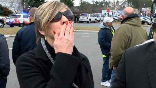 Jennifer Bulk, Jackson, who worked with Victor Lugo at a landscaping company, blows a kiss in memory of Lugo outside of Lakewood Public Works on Sunday, December 30, 2018, before his funeral procession passed there.  Lugo, who worked at the Public Works, was among the four men killed in a crash on the Garden State Parkway early Wednesday morning.