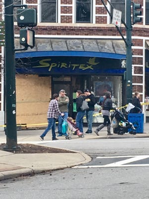 Spiritex clothing store in downtown Asheville remained closed Sunday after an accident the night before injured two pedestrians