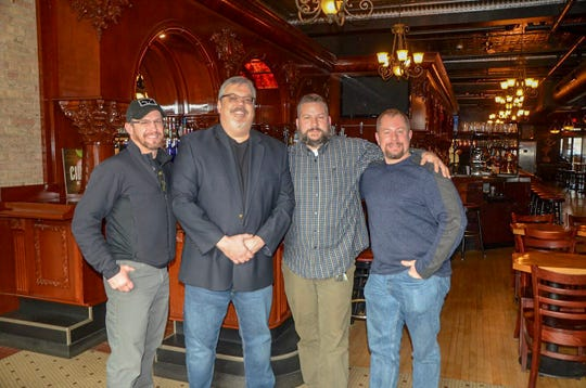 Jared Fulton (left) took over downtown pub Cricket Club from Jeff Adams with Jeremy Kanaga and his brother Joel Fulton in November 2018.