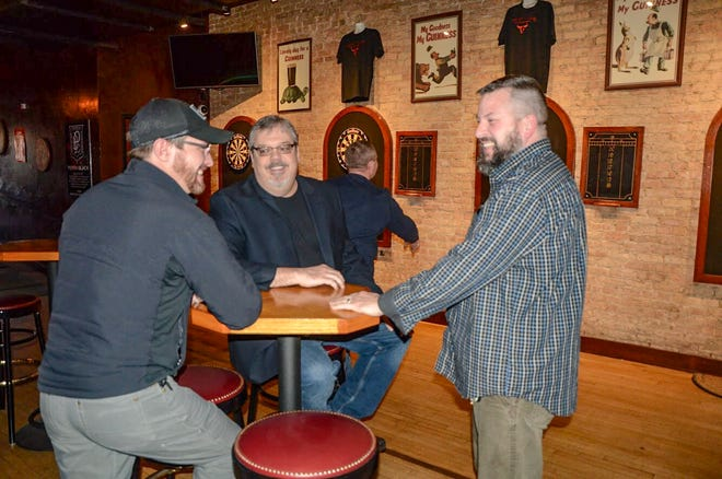 Jared Fulton (left) took over downtown pub Cricket Club from Jeff Adams with his brother Joel Fulton and Jeremy Kanaga in November 2018.