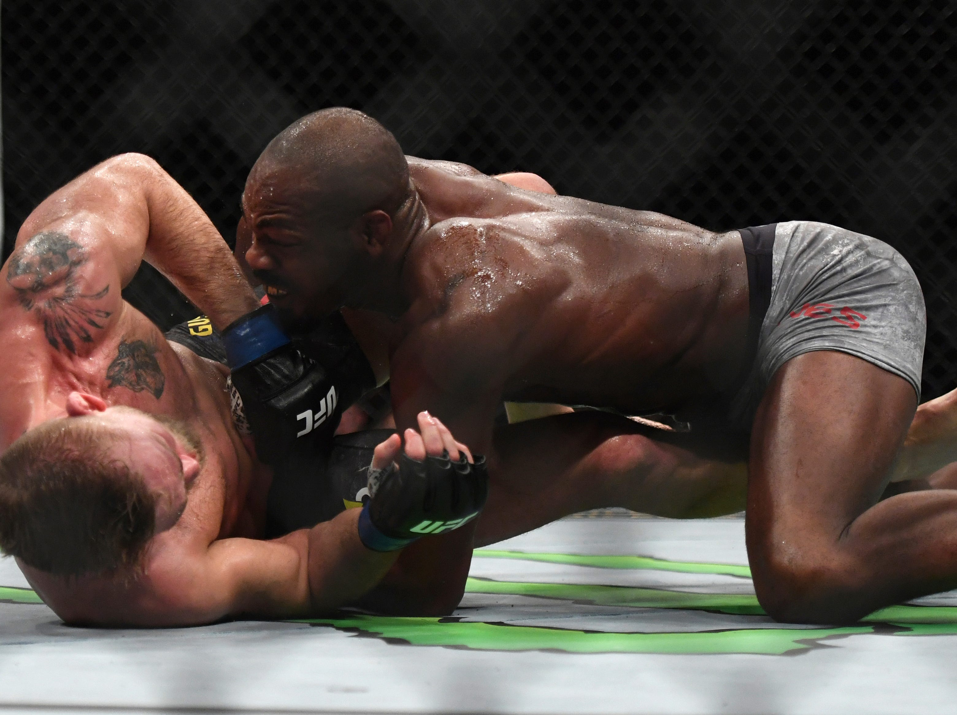 Jon Jones, right, takes Alexander Gustafsson to the ground during the UFC men's light heavyweight mixed martial arts bout at UFC 232, Saturday, Dec. 29, 2018, in Inglewood, Calif. (AP Photo/Kyusung Gong)