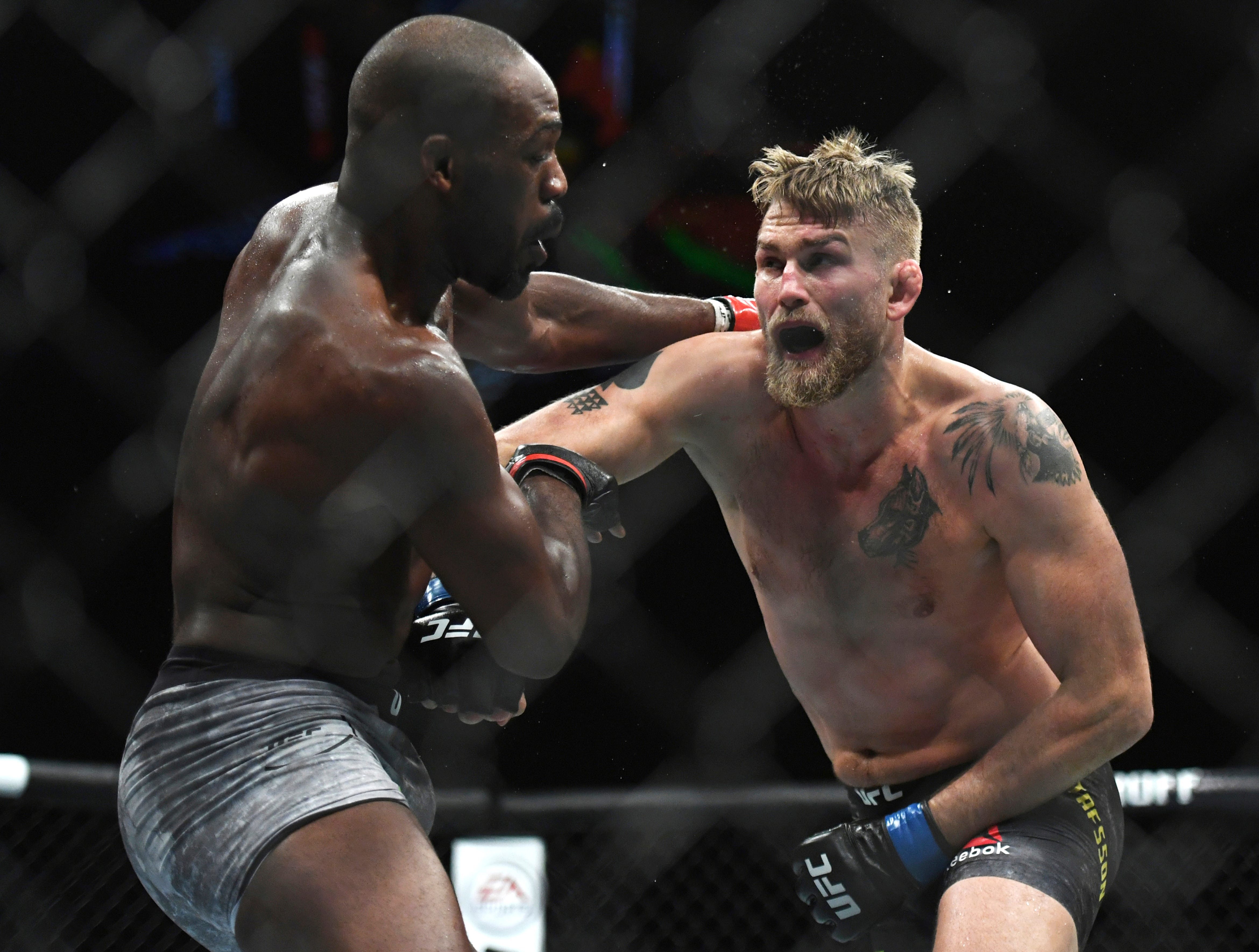Alexander Gustafsson, right, lands a punch to Jon Jones during the UFC men's light heavyweight title mixed martial arts bout at UFC 232, Saturday, Dec. 29, 2018, in Inglewood, Calif. (AP Photo/Kyusung Gong)