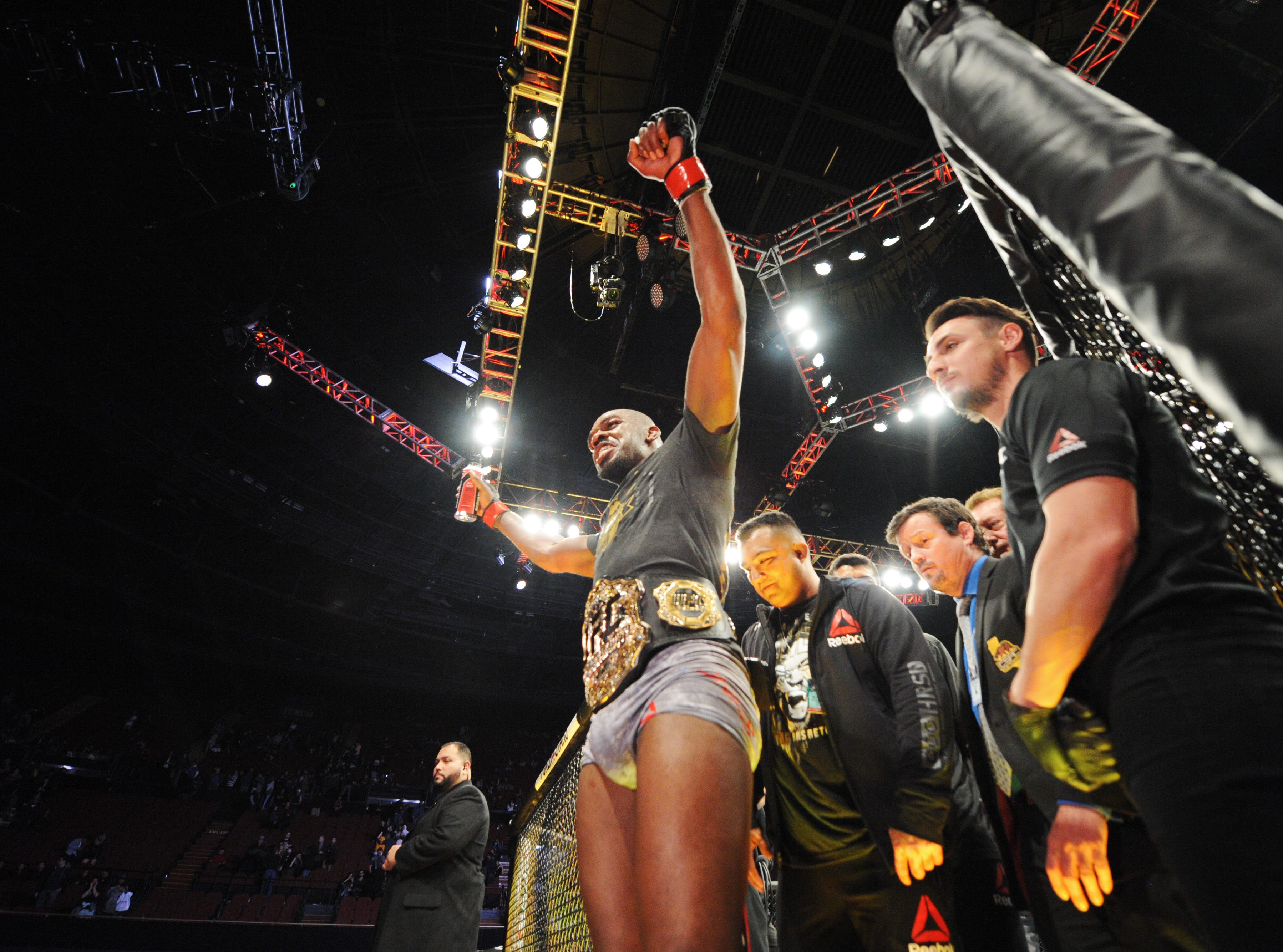 Dec 29, 2018; Los Angeles, CA, USA; Jon Jones (red gloves) exits the octogon after his victory over Alexander Gustafsson (not pictured) during UFC 232 at The Forum. Mandatory Credit: Gary A. Vasquez-USA TODAY Sports