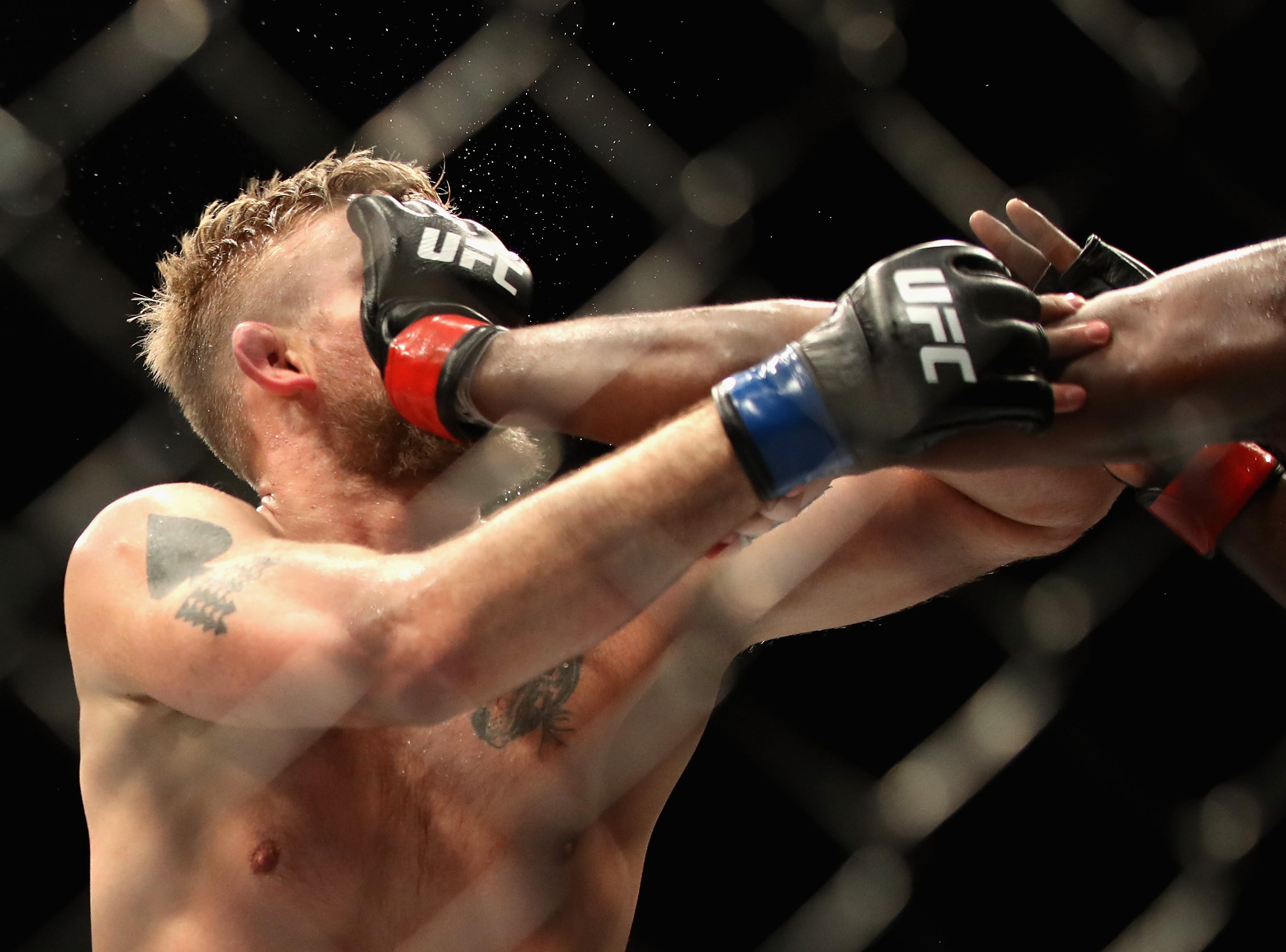 INGLEWOOD, CA - DECEMBER 29:   Alexander Gustafsson of Sweden is hit in the fact by Jon Jones during a Light Heavyweight titlebout during the UFC 232 event inside The Forum on December 29, 2018 in Inglewood, California.   Jones defeated Gustafsson by KO.  (Photo by Sean M. Haffey/Getty Images)
