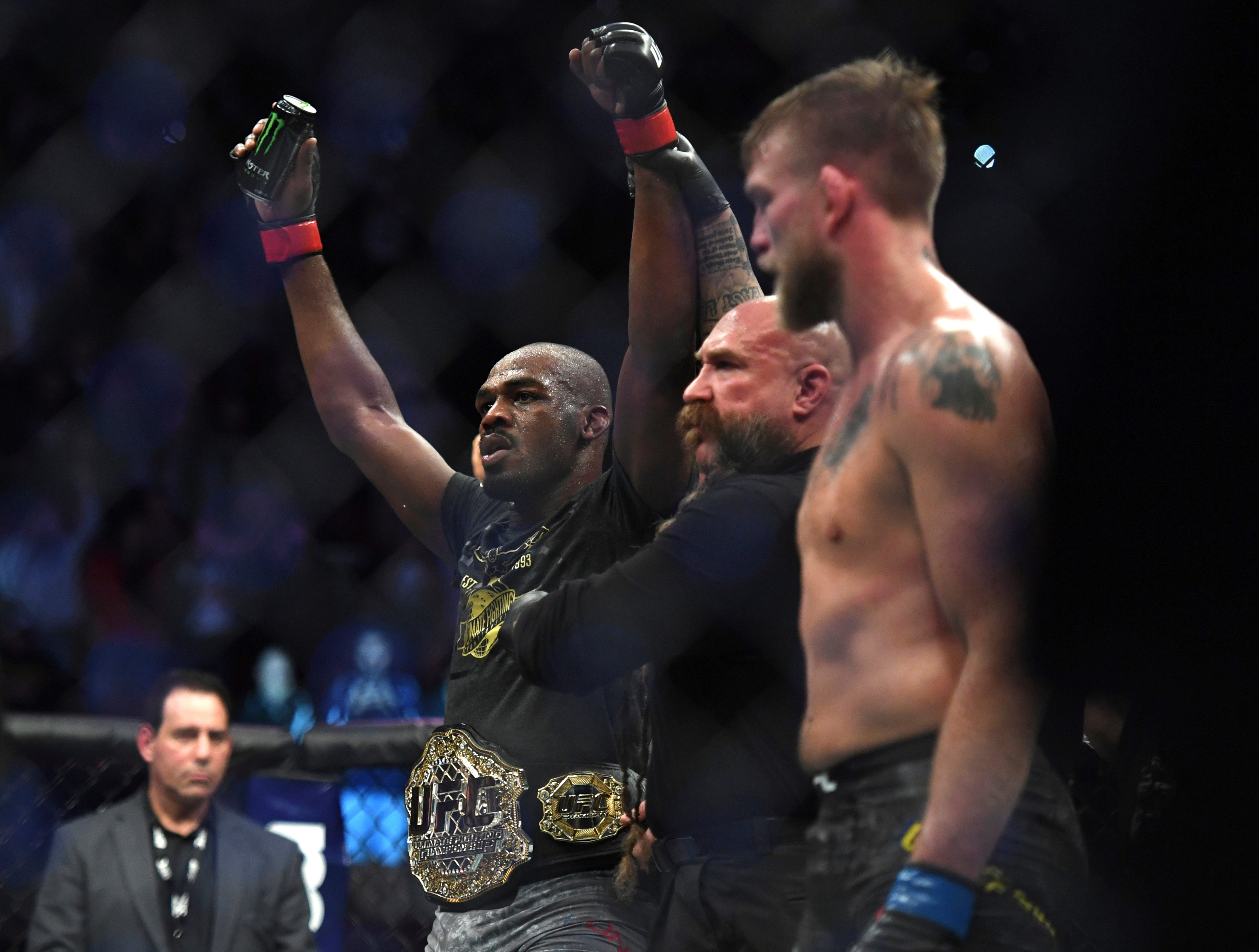 Jon Jones, left, celebrates as the referee raises his arms after Jones defeated Alexander Gustafsson in the UFC men's light heavyweight mixed martial arts bout at UFC 232, Saturday, Dec. 29, 2018, in Inglewood, Calif. (AP Photo/Kyusung Gong)