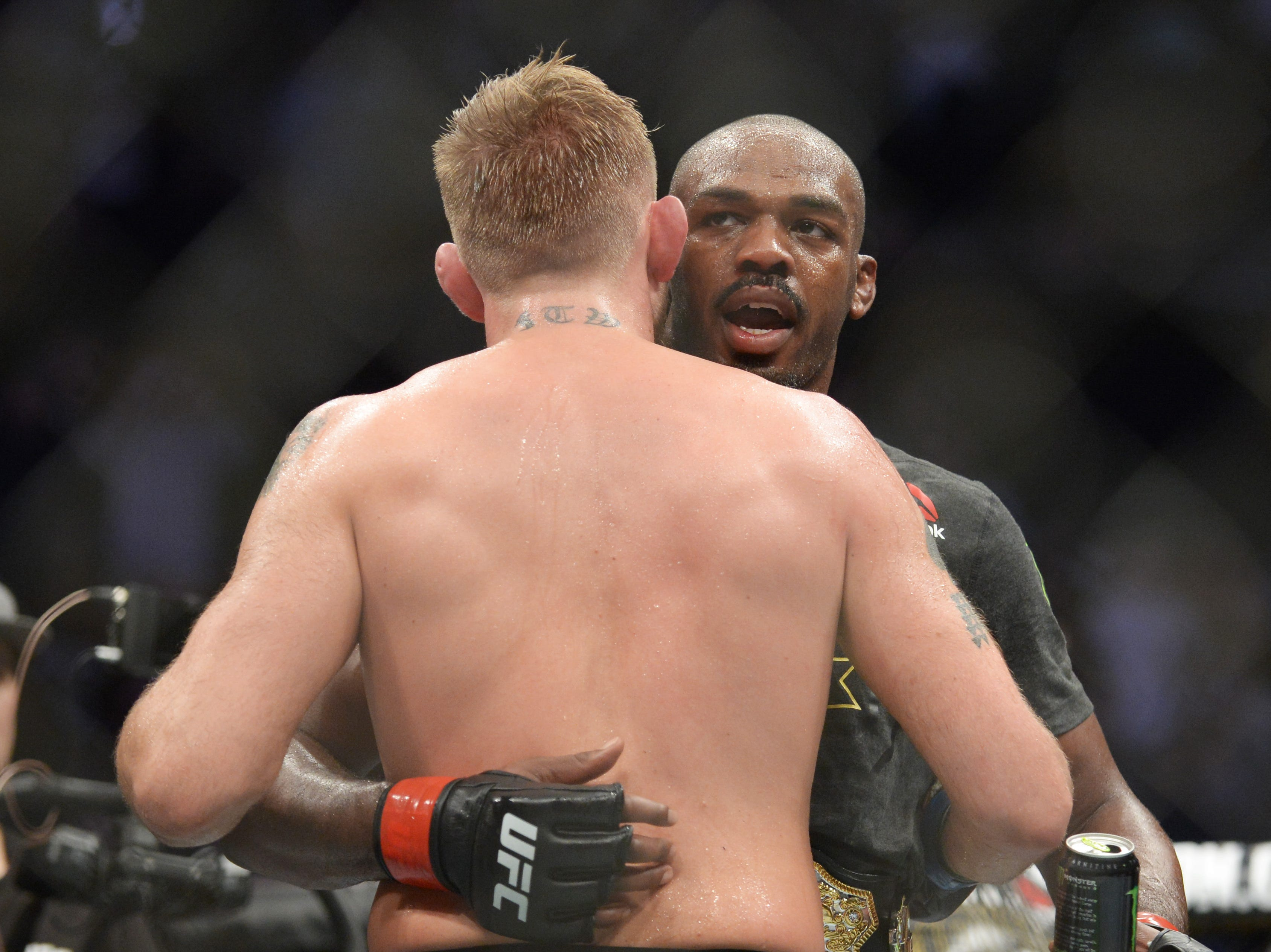 Dec 29, 2018; Los Angeles, CA, USA; Jon Jones (red gloves) hugs Alexander Gustafsson (blue gloves) after their fight during UFC 232 at The Forum. Mandatory Credit: Gary A. Vasquez-USA TODAY Sports