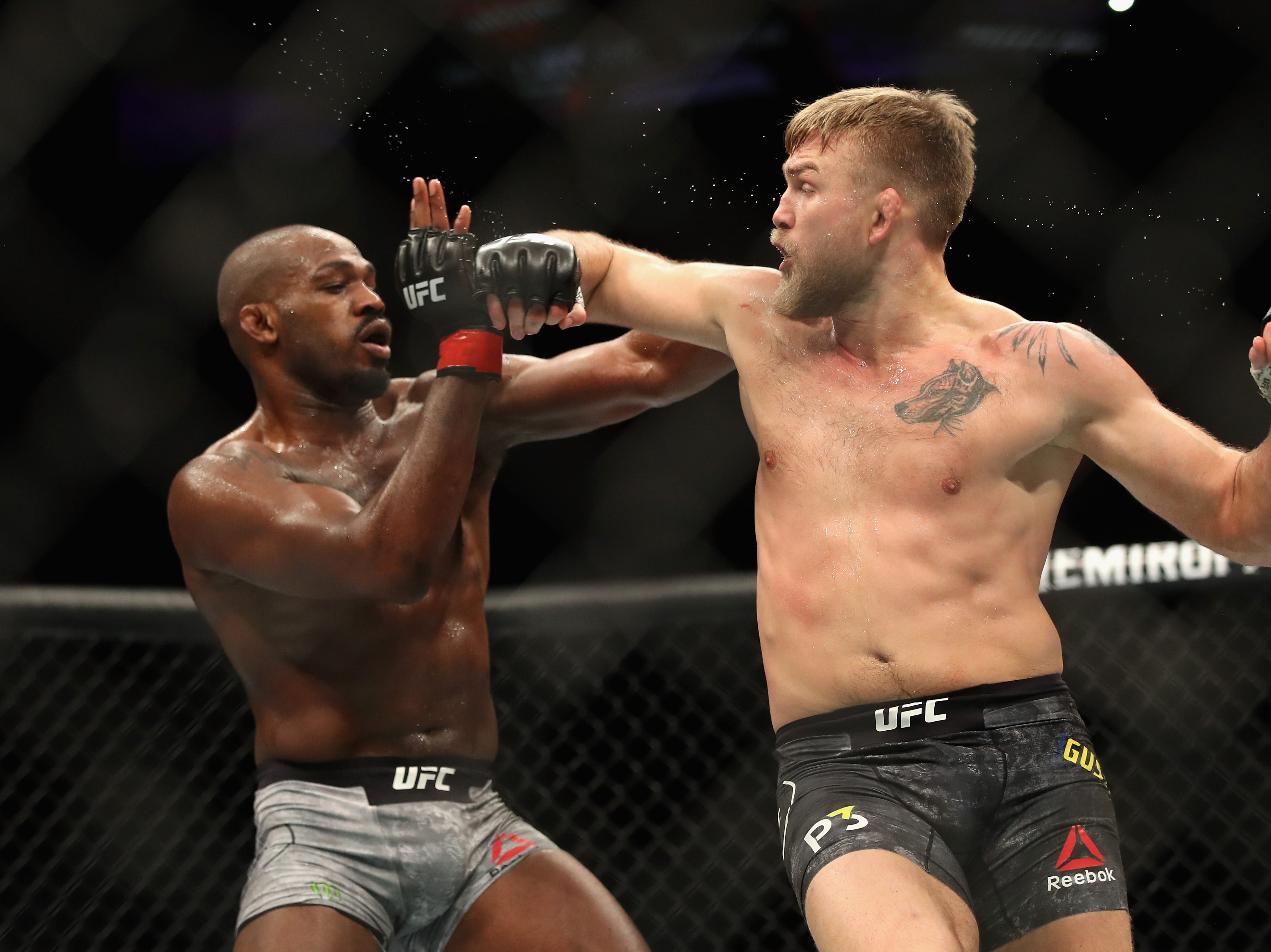 INGLEWOOD, CA - DECEMBER 29:  Jon Jones (left) avoids a punch by Alexander Gustafsson of Sweden (right) during a Light Heavyweight titlebout during the UFC 232 event inside The Forum on December 29, 2018 in Inglewood, California.   Jones defeated Gustafsson by KO.  (Photo by Sean M. Haffey/Getty Images)