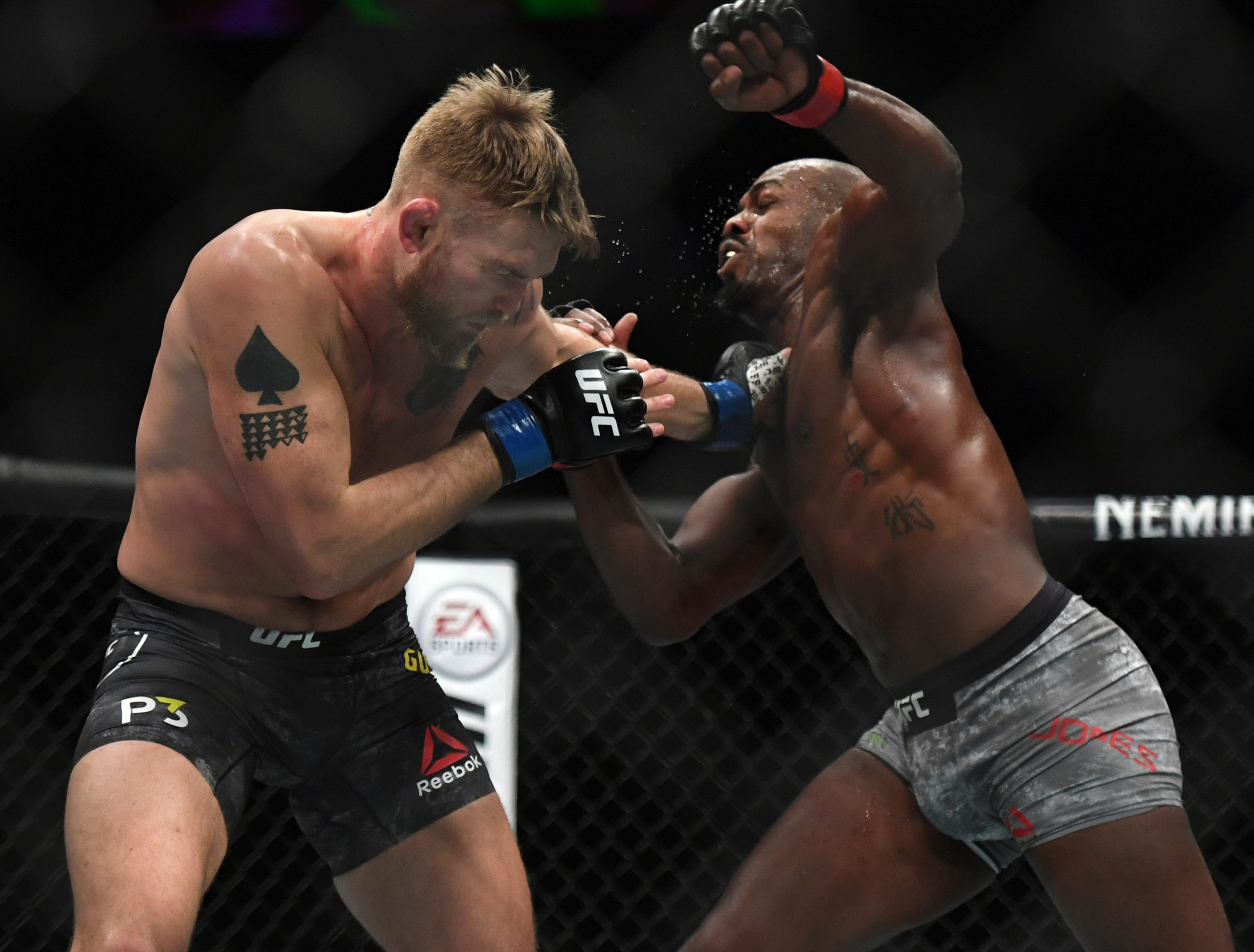 Alexander Gustafsson, left, and Jon Jones exchange punches during the UFC men's light heavyweight mixed martial arts bout at UFC 232, Saturday, Dec. 29, 2018, in Inglewood, Calif. (AP Photo/Kyusung Gong)