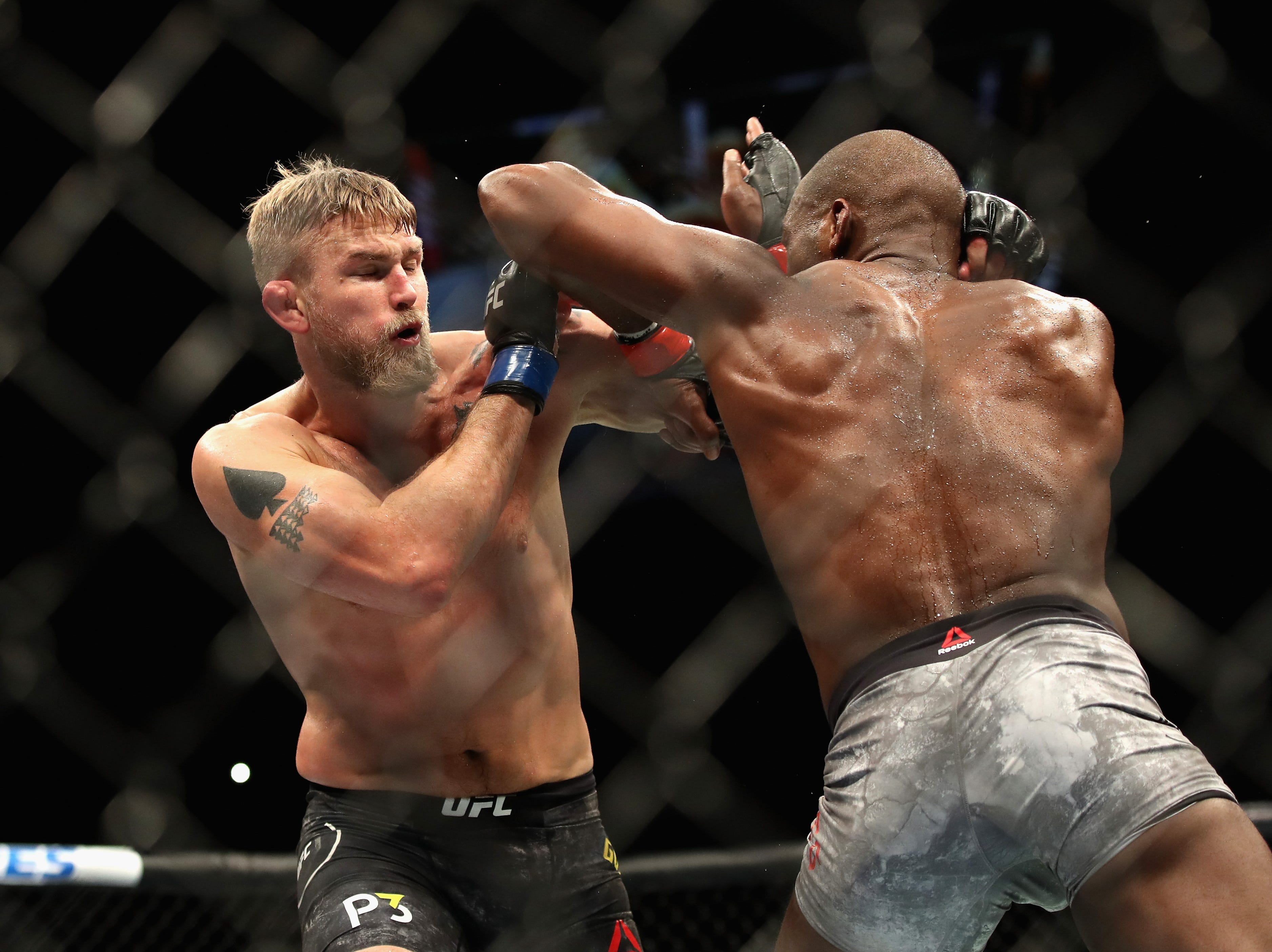 INGLEWOOD, CA - DECEMBER 29:  Jon Jones (right) punches Alexander Gustafsson of Sweden (left) during a Light Heavyweight titlebout during the UFC 232 event inside The Forum on December 29, 2018 in Inglewood, California.   Jones defeated Gustafsson by KO.  (Photo by Sean M. Haffey/Getty Images)