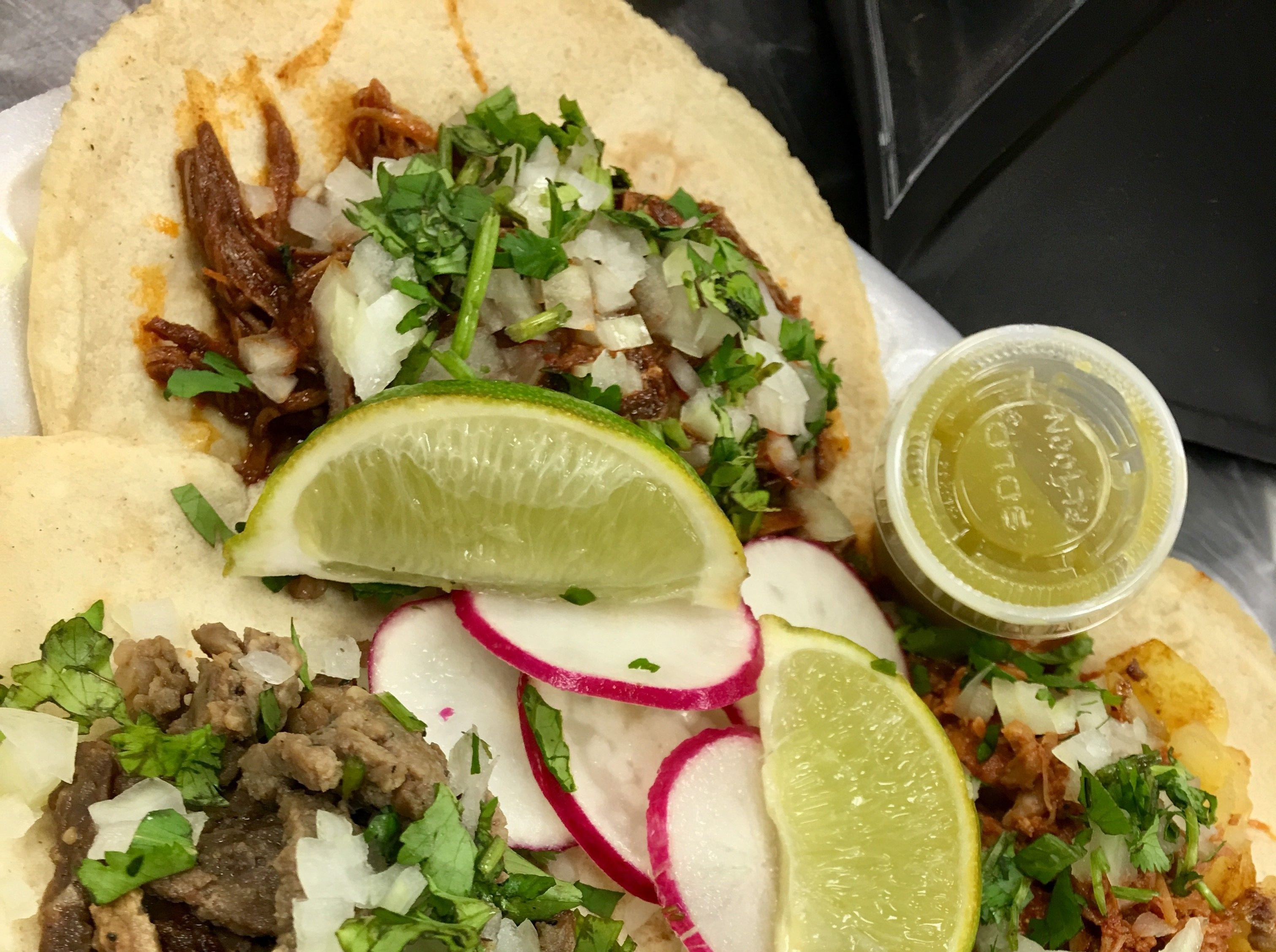 OPEN: Tacos at Sergio's Tacos in Viera come topped with onions and cilantro, with a mound of thin-sliced radishes in the center and a most welcome couple of wedges of lime, as well a small cup of zesty, Mexican-style green sauce.