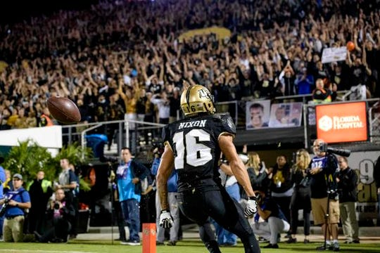 Central Florida Knights receiver Tre Nixon  (16) reacts to his touchdown during the first half against the Cincinnati Bearcats at Spectrum Stadium.