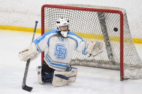 South Burlington goalie Lyssa Tan  makes a save during the girls hockey game between the Burlington-Colchester SeaLakers and the South Burlington Wolves last season.