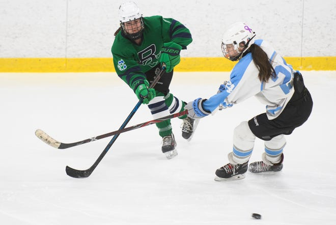 Burlington-Colchester's Meghan Lehouiller (4) shoots the puck during the girls hockey game between the Burlington-Colchester Sea Lakers and the South Burlington Wolves at Cairns Arena on Saturday afternoon December 29, 2018 in South Burlington.