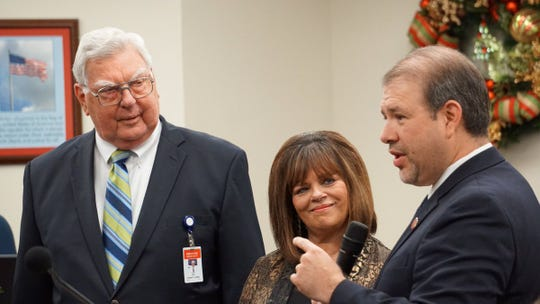 Pct. 3 Nueces County Commissioner John Marez, right, speaks about Nueces County Judge Loyd Neal, left, during Neal's last meeting as county judge on Dec. 12, 2018. Pictured in center is Pct. 1 County Commissioner Carolyn Vaughn.