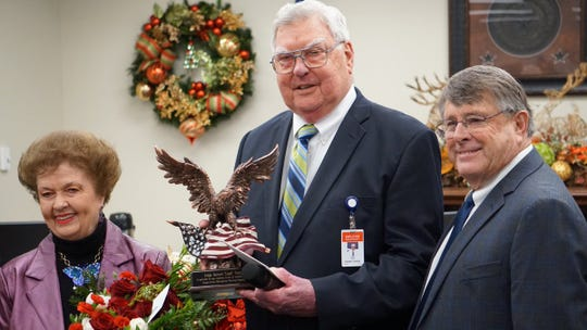 Pictured is Nueces County Judge Loyd Neal (center); his wife, Thetis (left); and Port of Corpus Christi Commission Chair Charlie Zahn at Neal's last meeting as county judge on Dec. 12. Neal is holding an award honoring his service on the Metropolitan Planning Organization, as he readies for retirement from public service after four decades.