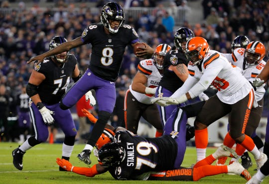 Baltimore Ravens quarterback Lamar Jackson (8) rushes for a touchdown in the first half of an NFL football game against the Cleveland Browns, Sunday, Dec. 30, 2018, in Baltimore.