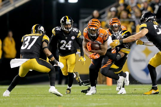 Cincinnati Bengals running back Joe Mixon (28) carries the ball as he's surrounded by Pittsburgh Steelers defenders in the second quarter of a Week 17 NFL football game, Sunday, Dec. 30, 2018, at Heinz Field in Pittsburgh. The Cincinnati Bengals lead 10-3 at halftime.