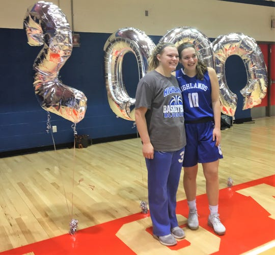 Highlands senior Zoie Barth, right, and senior teammate Chloe Jansen celebrate her 2,000th career point during Conner's 54-46 overtime win over Highlands in girls basketball in the finals of Conner's LaRosa's Holiday Classic Dec. 29, 2018, Hebron KY.