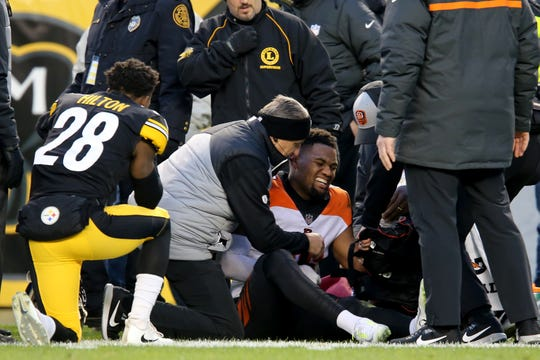 Cincinnati Bengals wide receiver Cody Core (16) is attended to after suffering an injury in the first quarter of a Week 17 NFL football game against the Pittsburgh Steelers, Sunday, Dec. 30, 2018, at Heinz Field in Pittsburgh. The Cincinnati Bengals lead 10-3 at halftime.