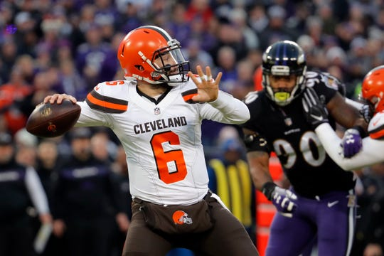 Cleveland Browns quarterback Baker Mayfield throws a pass in the first half of an NFL football game against the Baltimore Ravens, Sunday, Dec. 30, 2018, in Baltimore.