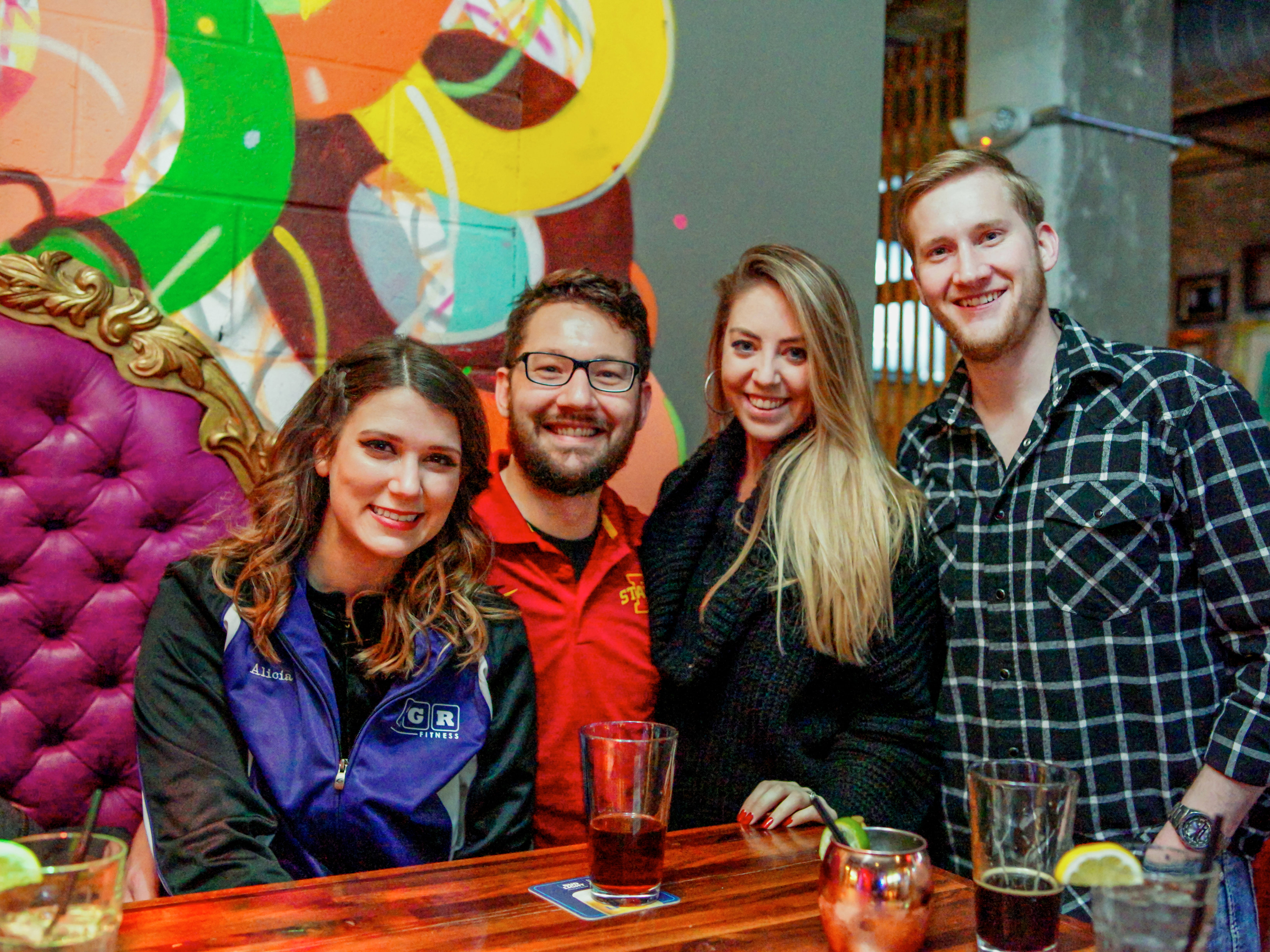 Alicia Bellville, 29, Paul Dudley, 28, Bayley Maurt, 29, and Orin McMillin, 28, all of Des Moines, having a fun time, Friday, December 28th, at 300 Craft and Rooftop.