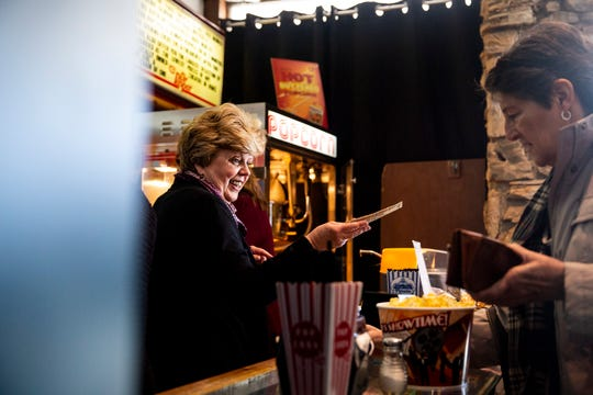 Denise Mahon, owner of the Varsity Theatre, works behind the concession counter on the theater's last day of operation on Sunday, Dec, 30, 2018, in Des Moines. Mahon's father opened the one-screen movie theater in 1938.