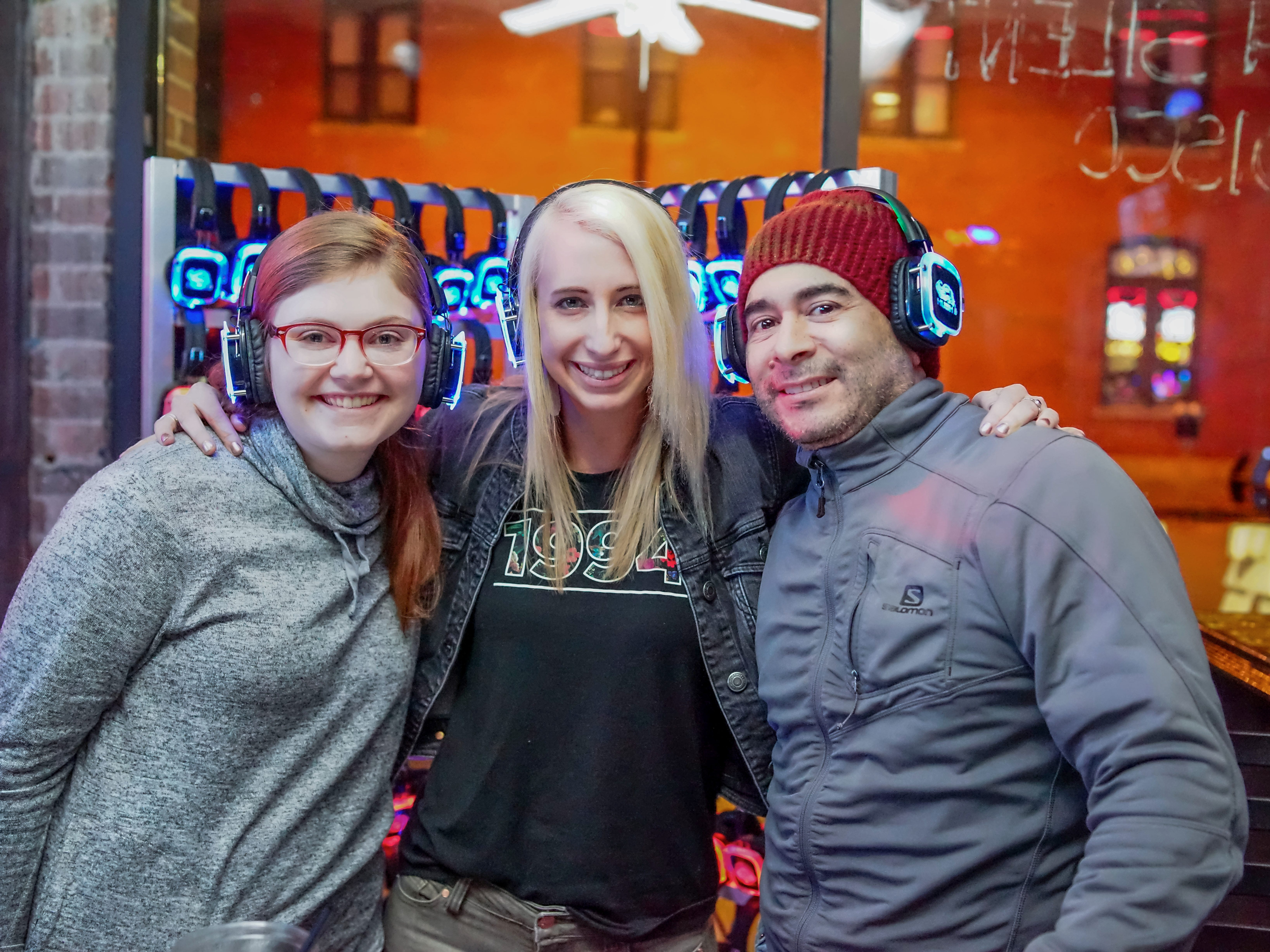 Jessica Sawatzky, 24, Vincent Munoz, 33, and Lydia Richards, 22, all of Des Moines, having a fun time, Friday, December 28th, at Hush.
