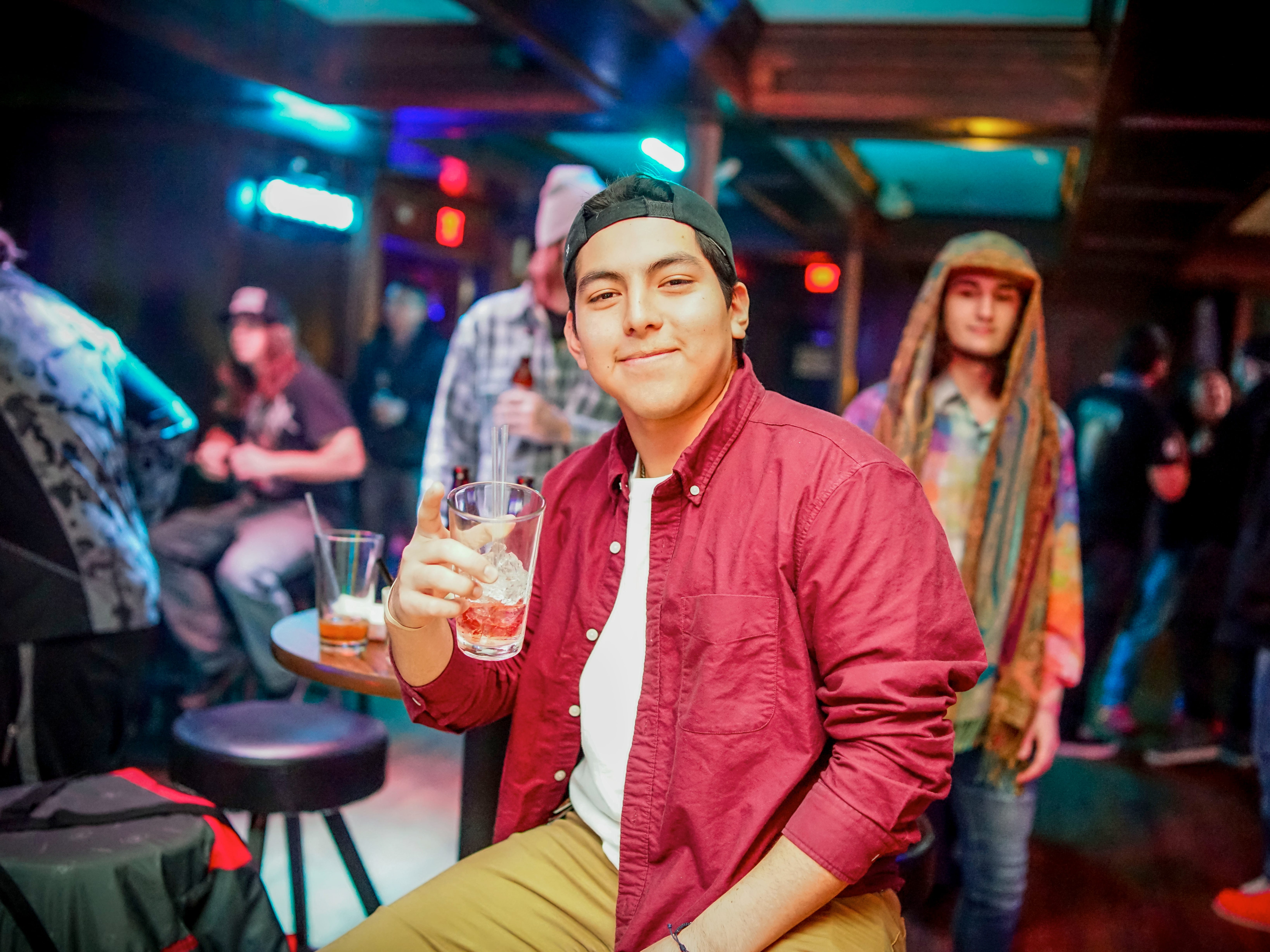 Alex Sanchez, 21, of Des Moines, having a fun time, Friday, December 28th, at Heroes.