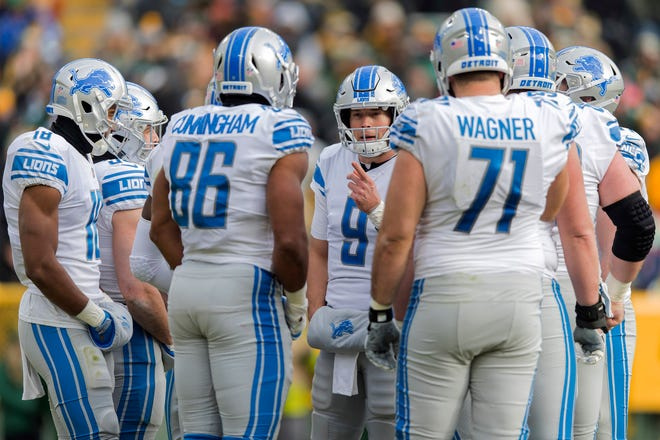 Lions quarterback Matthew Stafford talks during a huddle during the first half on Sunday, Dec. 30, 2018, in Green Bay, Wis.