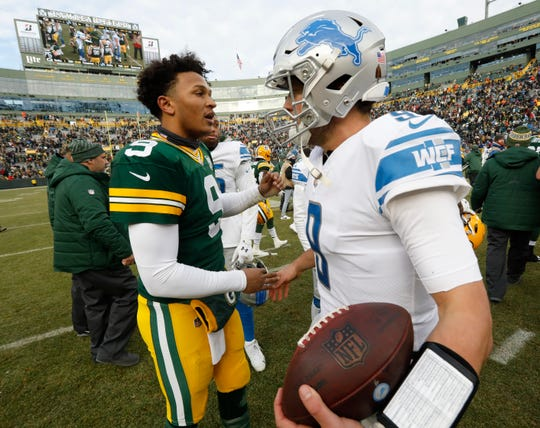 Packers quarterback DeShone Kizer talks to Lions quarterback Matthew Stafford after the Lions' 31-0 win on Sunday, Dec. 30, 2018, in Green Bay, Wis.