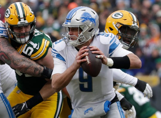 Lions quarterback Matthew Stafford scrambles during the first half on Sunday, Dec. 30, 2018, in Green Bay, Wis.
