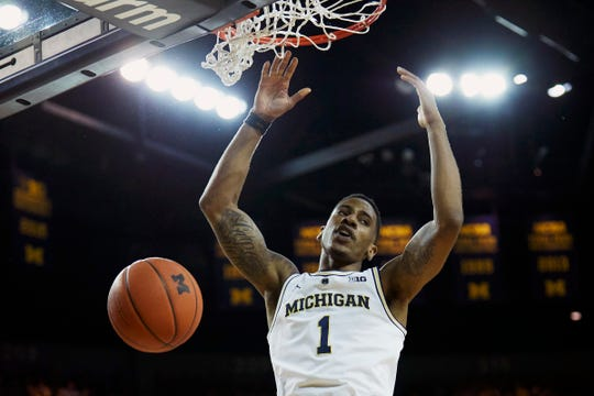 Michigan guard Charles Matthews dunks during the first half on Sunday, Dec. 30, 2018, at Crisler Center.