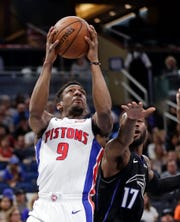Pistons guard Langston Galloway goes to the basket past the Magic's Jonathon Simmons during the first half on Sunday, Dec. 30, 2018, in Orlando, Fla.