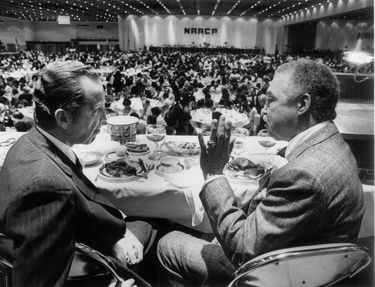 Michigan Governor William Milliken and Detroit Mayor Young attend the annual NAACP Fight for Freedom Fund dinner in April 1981 agreed over their support for both the state and the city tax proposals.