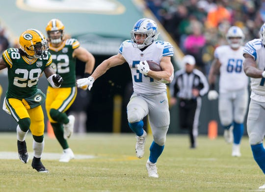 Zach Zenner runs the ball during the third quarter Sunday against the Packers.