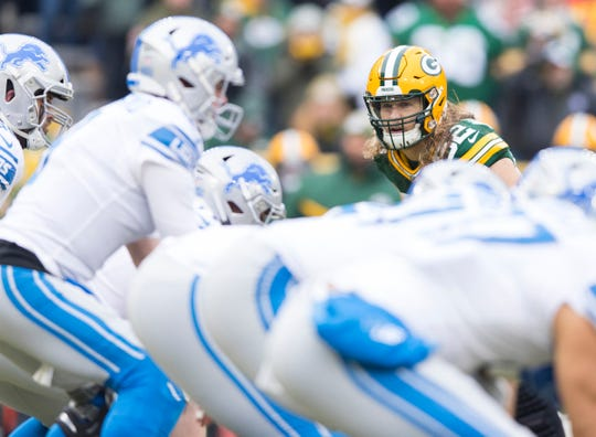 Packers linebacker Clay Matthews looks in on Lions quarterback Matthew Stafford prior to a play during the first half on Sunday, Dec. 30, 2018, in Green Bay, Wis.