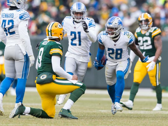 Lions cornerback Quandre Diggs celebrates after intercepting a pass from Packers quarterback DeShone Kizer during the fourth quarter of the Lions' 31-0 win on Sunday, Dec. 30, 2018, in Green Bay, Wis.