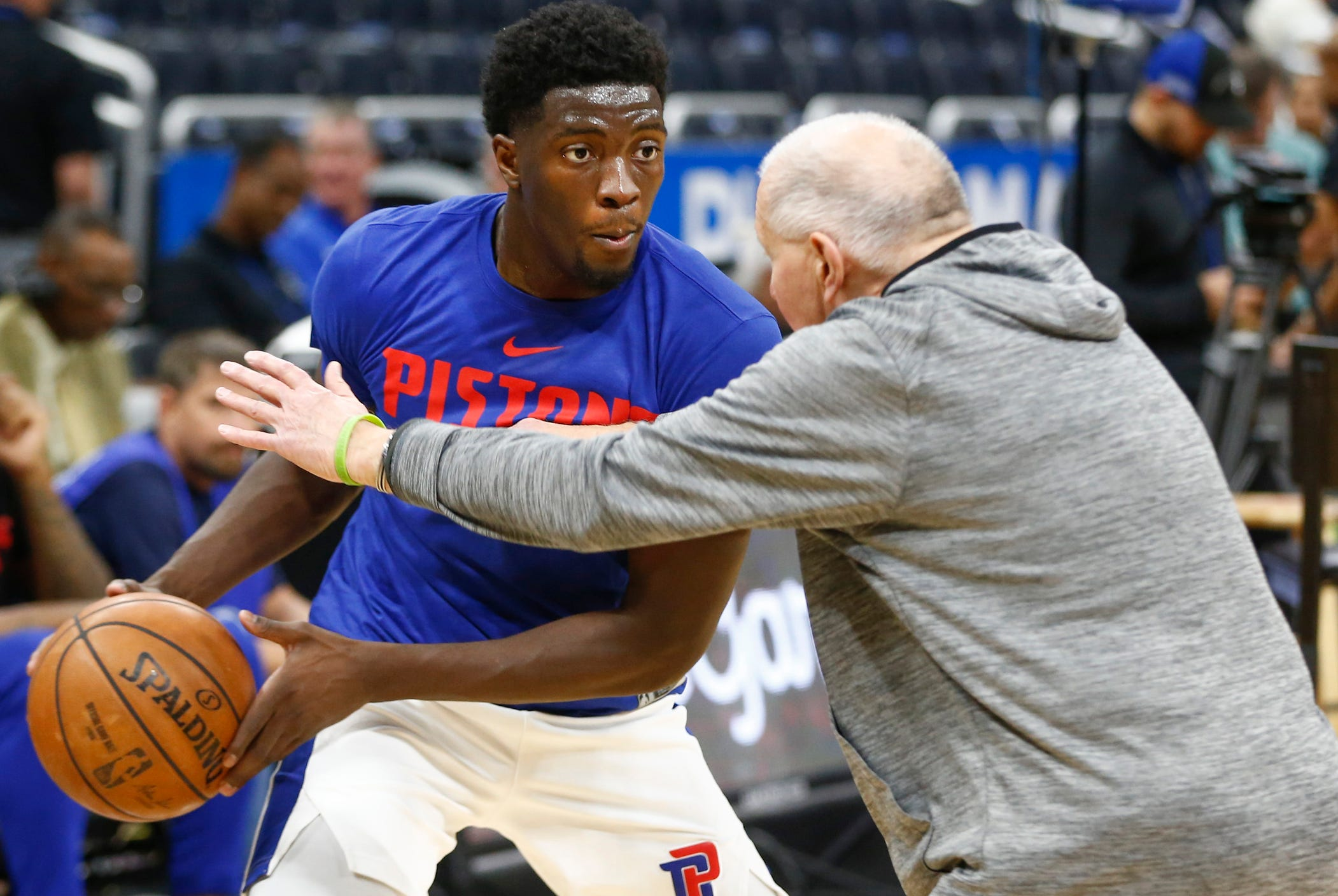 Pistons guard Khyri Thomas works out with an assistant before the game against the Magic on Dec. 30, 2018, in Orlando, Fla.